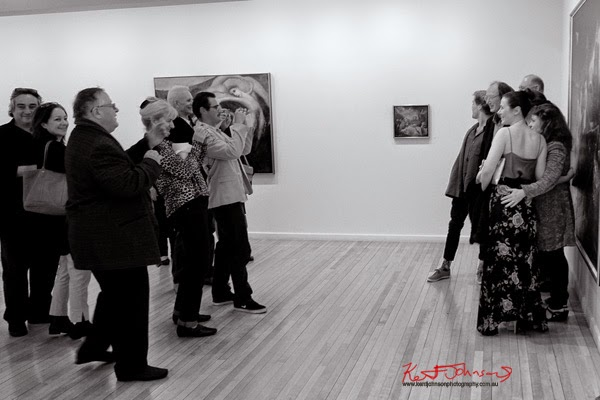 Family and friends being photographed, Garry Shead at Australian Galleries Sydney