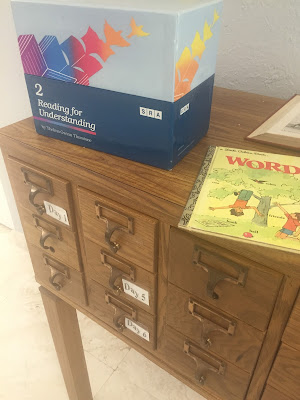 A Library card catalog,  a SRA box and a Golden Book