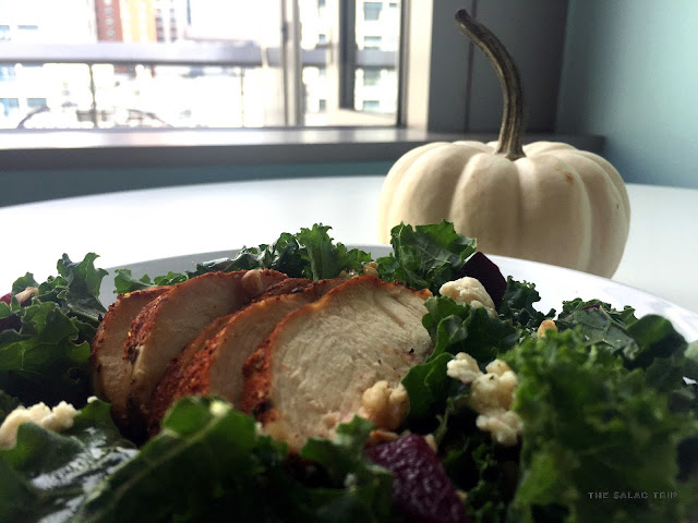 a white pumpkin and a plate of kale salad on a table