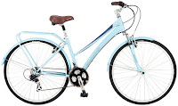 Schwinn Women's Community 700c Hybrid Bicycle, with Shimano 21-speed rear derailleur & SRAM Grip Shifters, suspension fork, quick-release front wheel, full fenders, rear rack, wide padded seat, suspension seat post,