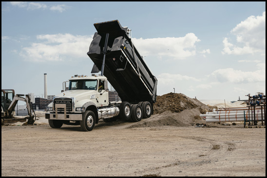 Mack Trucks is making shock absorbers standard on factory-installed auxiliary axles for its Mack® Granite® models to help reduce tire wear and improve driver comfort