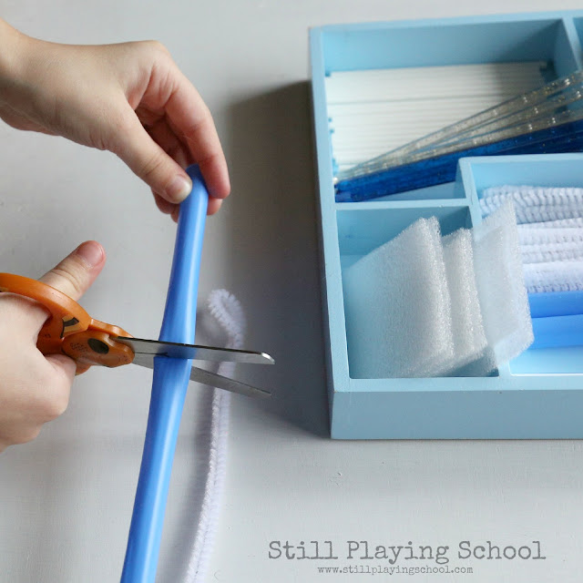 Kids can work on cutting practice with a winter inspired tinker tray!