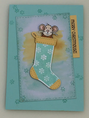 Mouse peeking out of a Christmas stocking