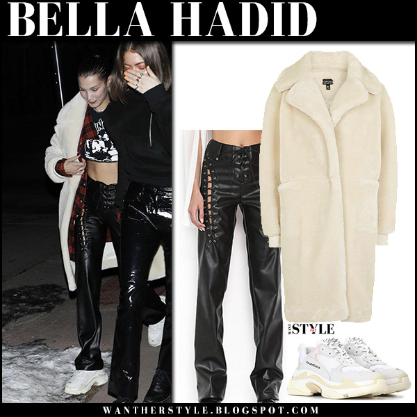 Bella Hadid in cream faux fur coat, black leather pants i.am.gia and white sneakers winter street style december 29