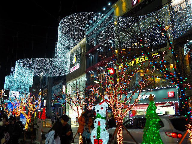 Gwangbok-ro street with Christmas lights including trees, snowmen and overhead banner, in Nampo, Busan, South Korea