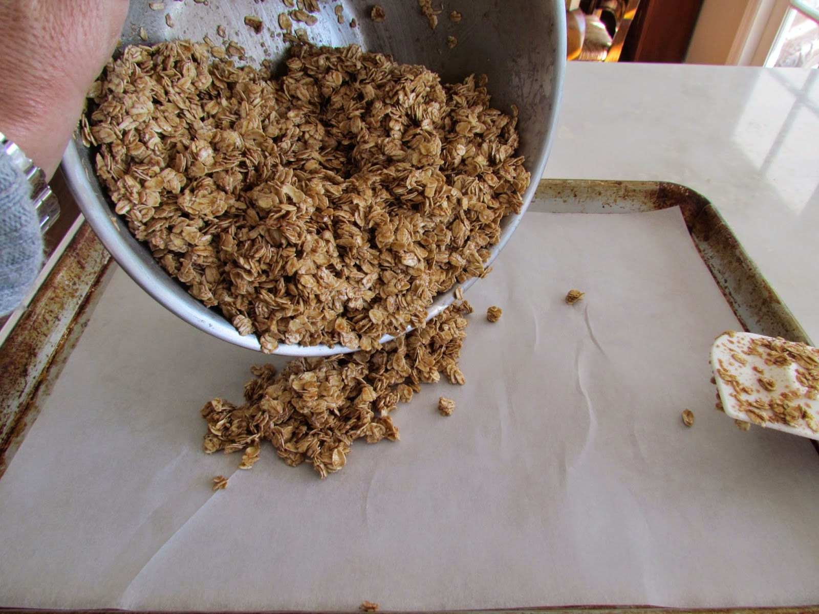 Pouring out the granola mix