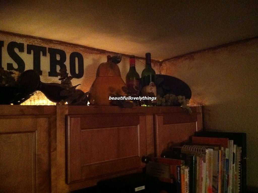 BeautifulLovelyThings: Above Kitchen Cabinet Decor - Tuscan Themed Kitchen Decor