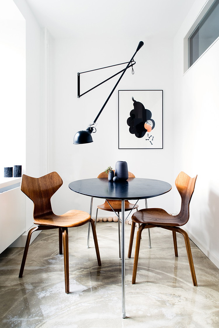 How to light a dining room without a ceiling light, alternative dining room lighting ideas, lighting above the dining table, swing arm wall lamp above the dining table, long arm wall lamp in the dining room. Photo via Reform
