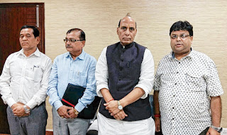 Roshan Giri Dr Rohit Sharma and other Morcha leaders with Rajnath Singh