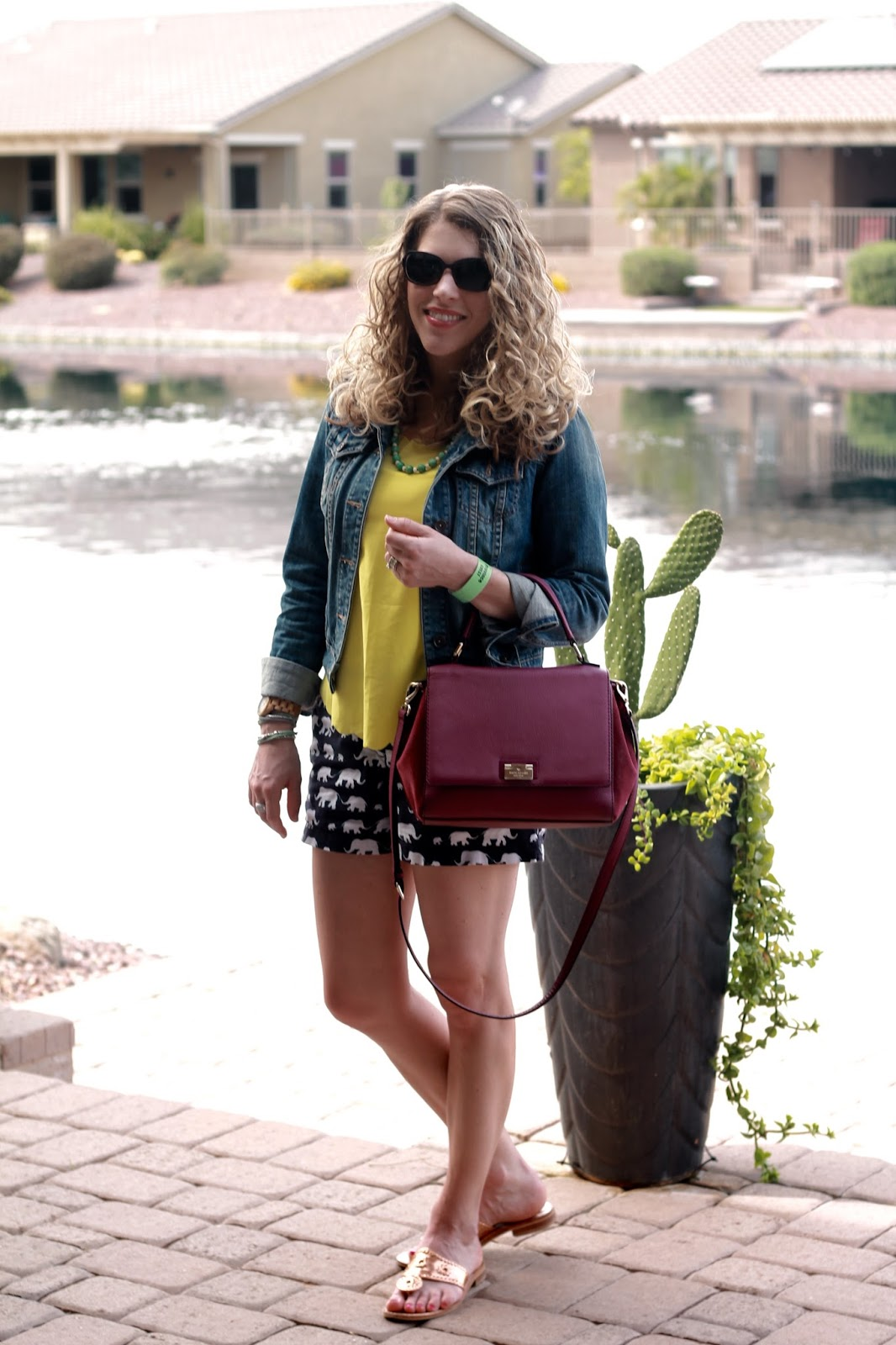 yellow scalloped top, elephant print shorts, denim jacket, plum kate spade bag, rose gold jack rogers sandals, spring outfit