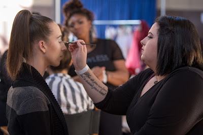 model Morgan Pashen in hair and makeup backstage at KCFW