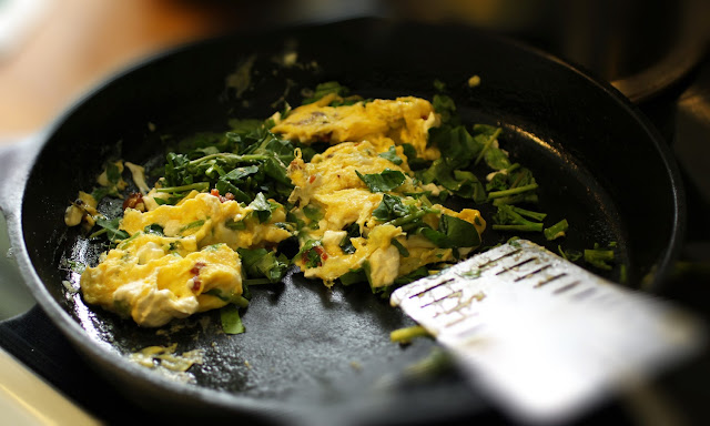 watercress goat cheese scrambled eggs w/bacon in the skillet