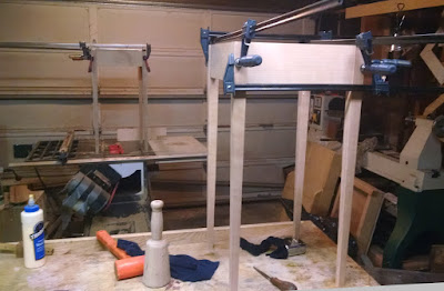Clamped table bases
