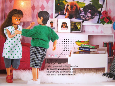 Modern dolls' house scene of two dolls dancing in front of a stereo.