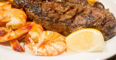 Grilled Steak and Shrimp, with a Half a Lemon