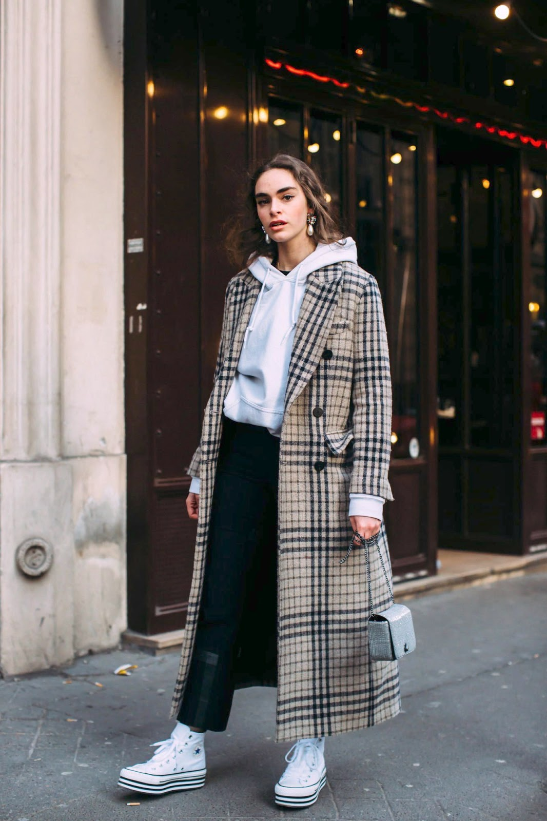 The Cool-Girl Way to Wear a Hoodie This Winter — Checked Plaid Coat, Black Pants, and Converse Sneakers