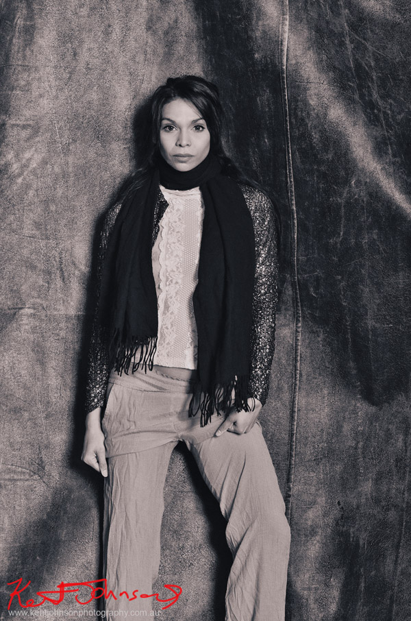 Sage Godrei, magazine style actors portrait; studio photography, black background, Sage mid shot in black and white shot.