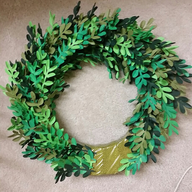 Making a faux boxwood wreath using paper cut with a silhouette cameo and gluing the stems on a foam wreath. Alternate colors to give it an authentic look
