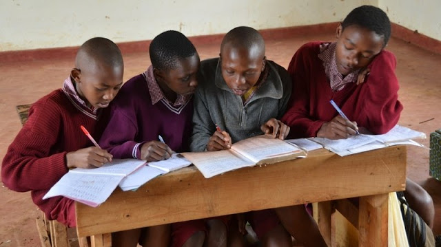 students share a desk Africa