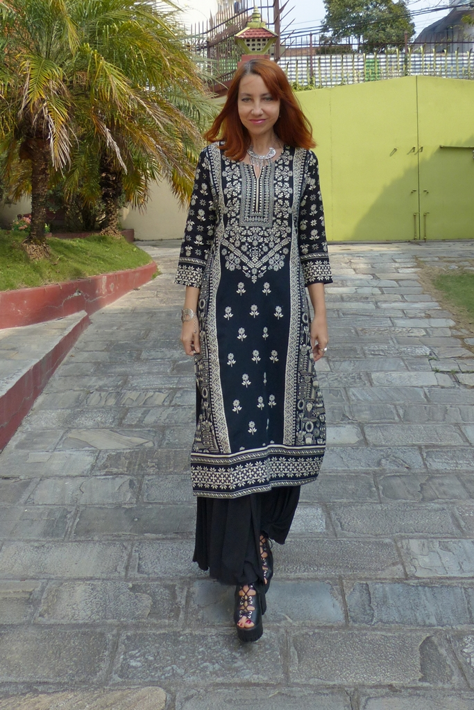 Boho look with ethnic tunic worn over maxi skirt