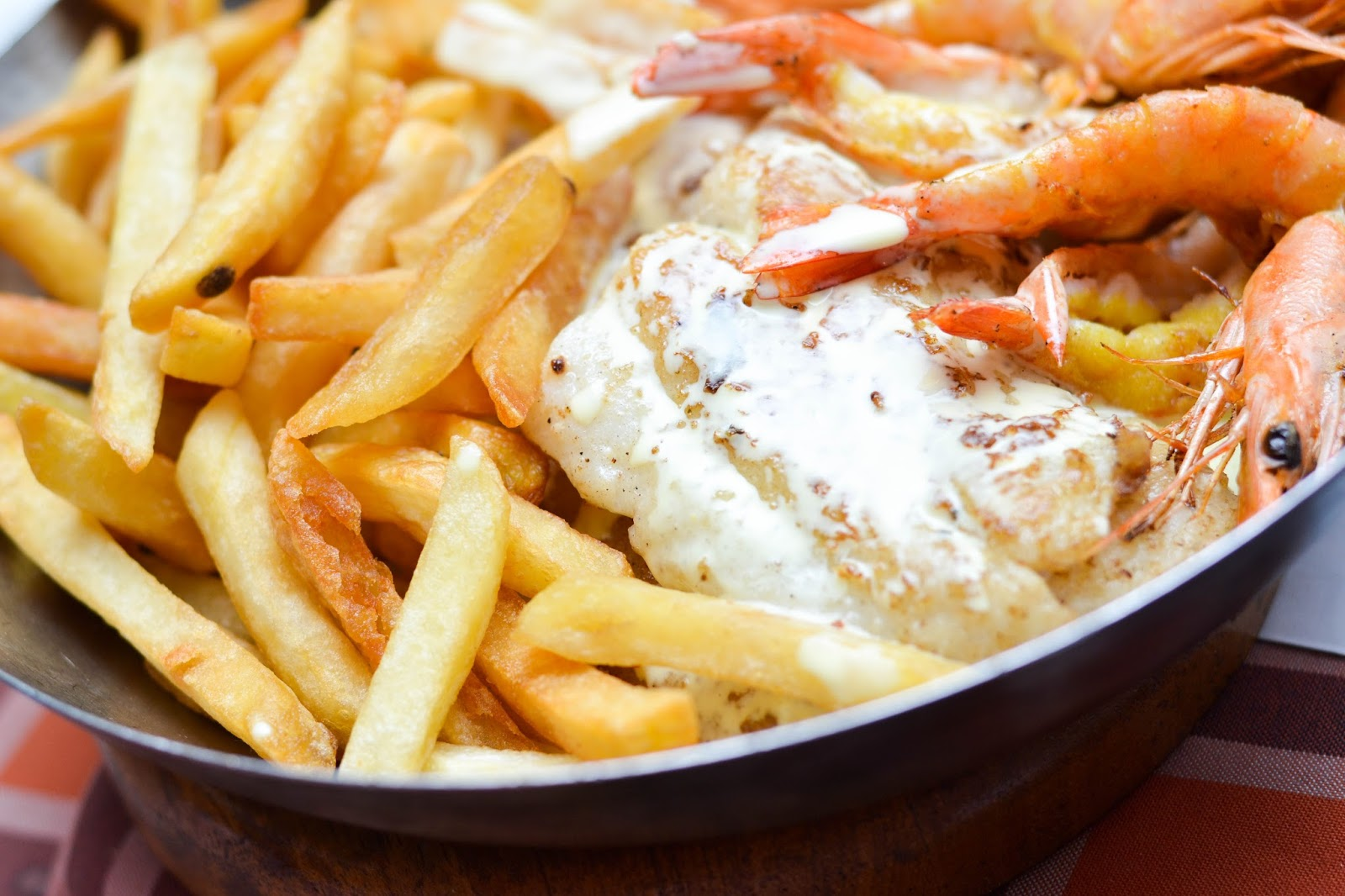 Prawns, Fish and Chips in a stainless steel bowl