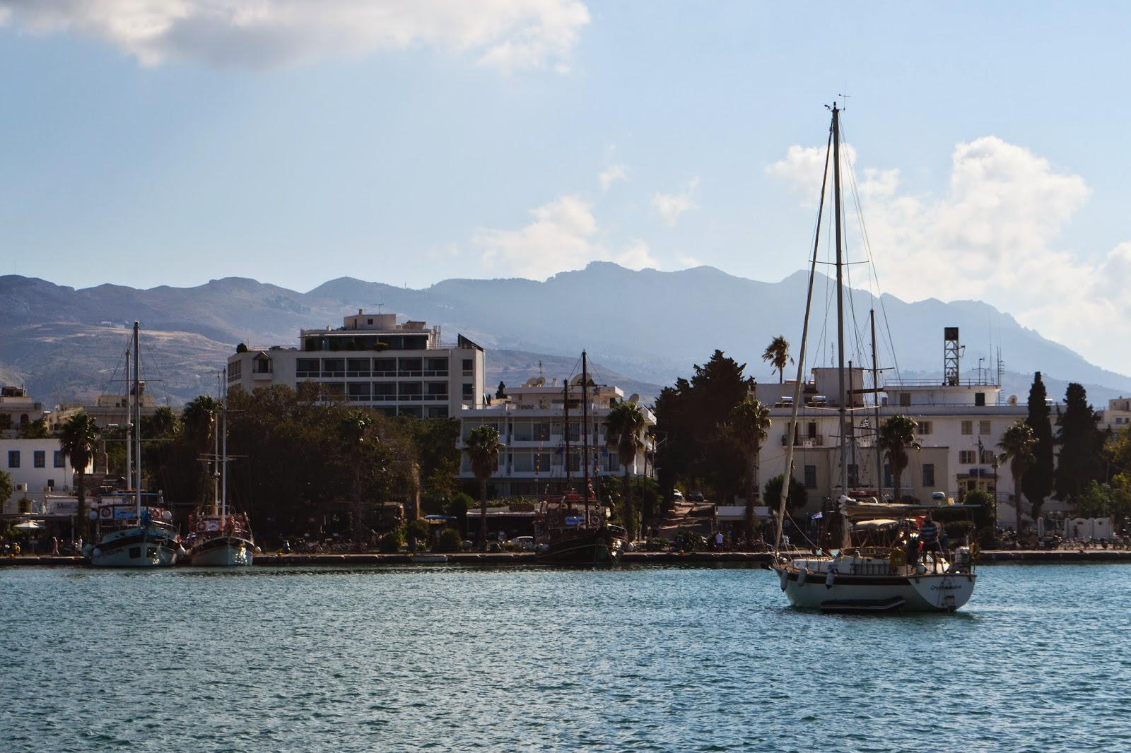 a boat coming into Kos Town Harbour