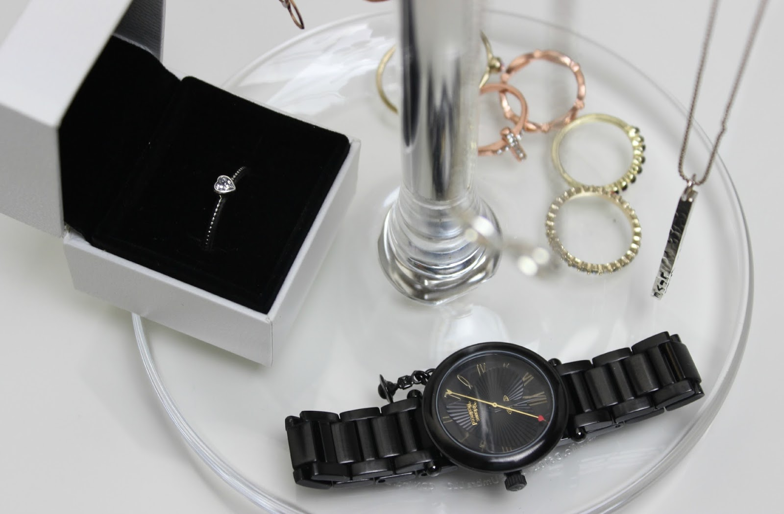 A picture of a Pandora ring and a Vivienne Westwood Black Orb Watch