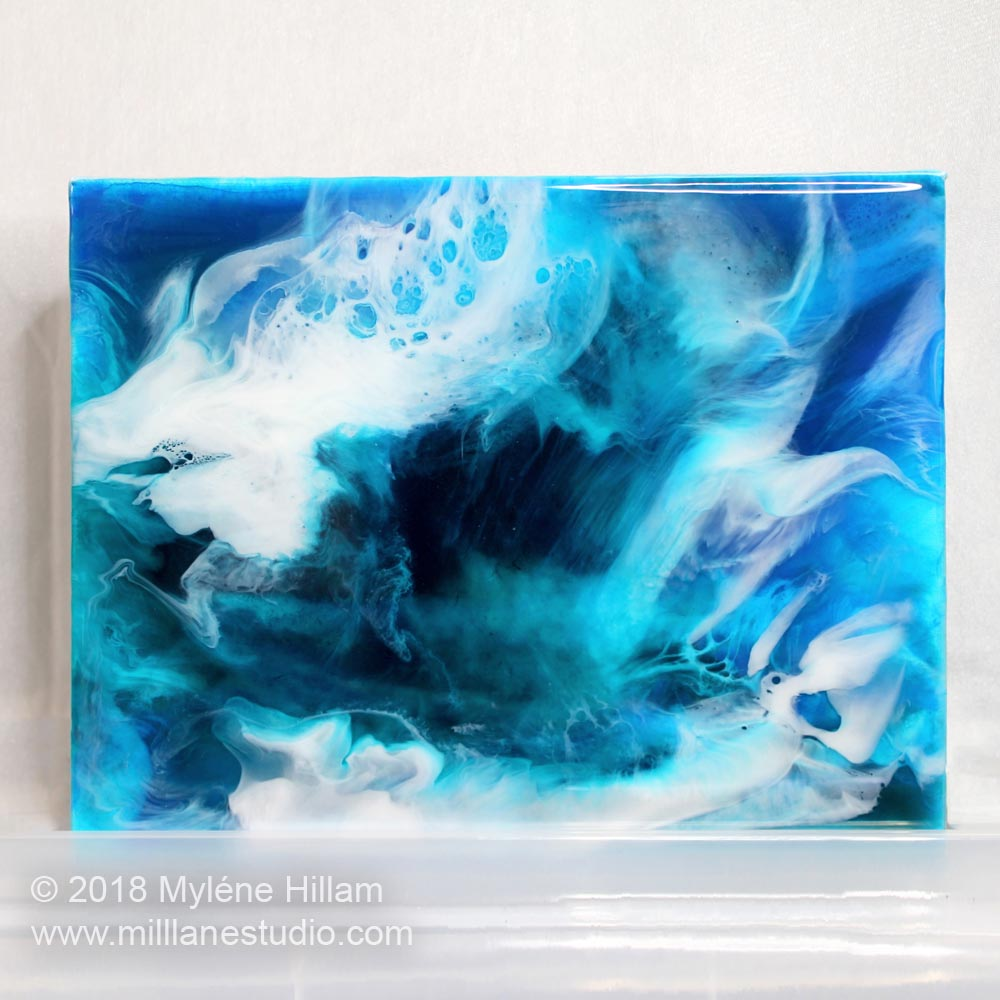 Ocean inspired resin art canvas featuring the lace effect. Painting is created with EnviroTex Lite, acrylic paints, Castin'Craft resin pigments and alcohol inks.
