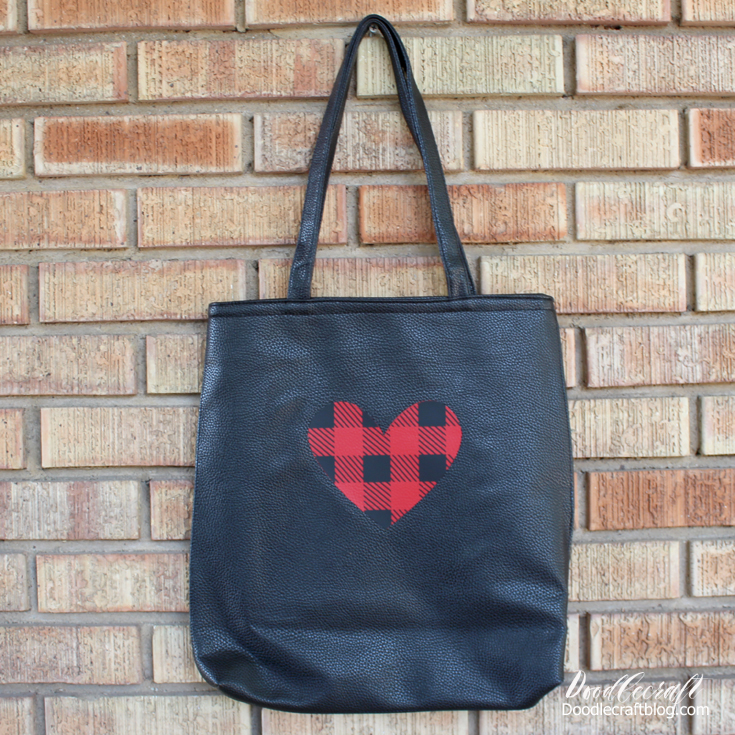 Using Cricut Maker and EasyPress to make a unique bag with a buffalo plaid heart ironed on it.