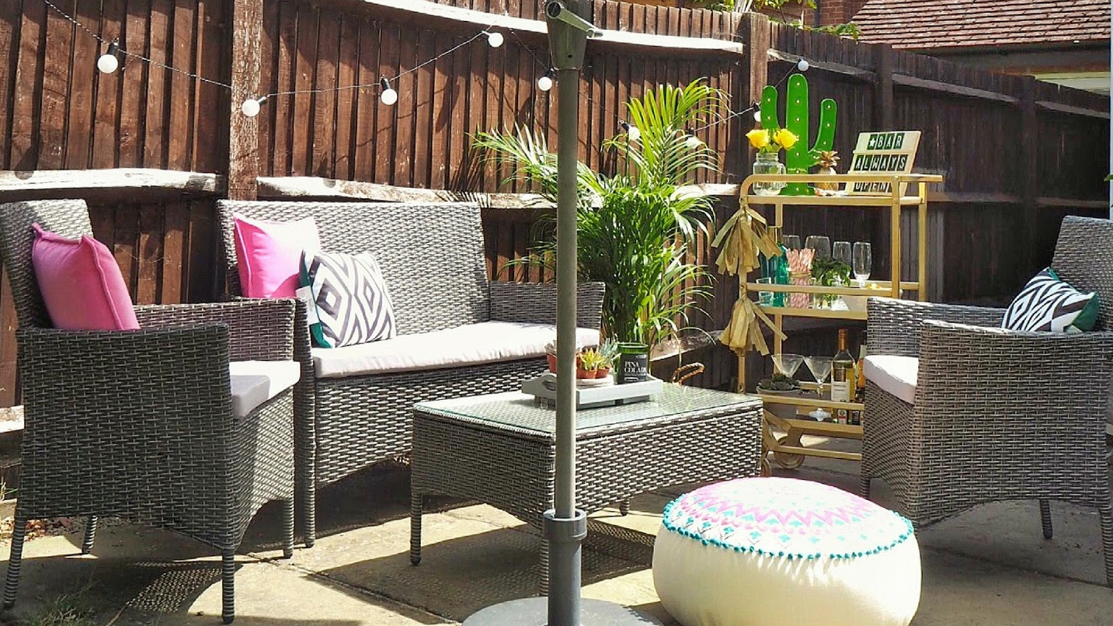 seven summer garden must-haves including outdoor sofa, chiminea, fire pit, bistro seating, festoon lights, glass drinks dispenser and egg chair.