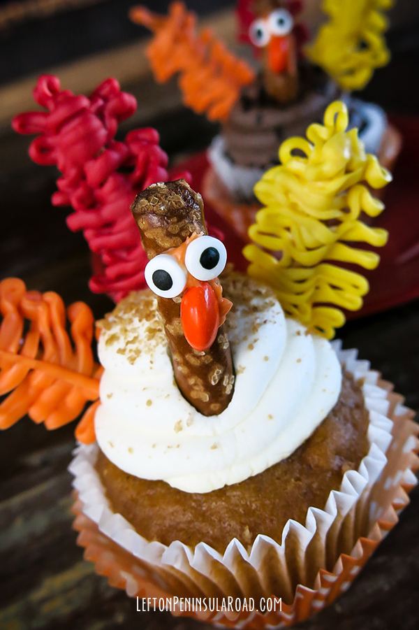 Dress up any cupcake with feathers and faces for Thanksgiving.