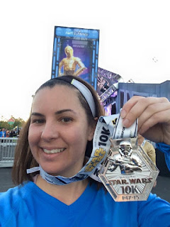 Showing off my runDisney Star Wars 10k race medal