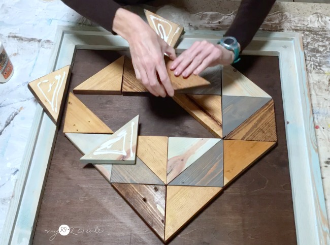 gluing on wood triangle heart pieces