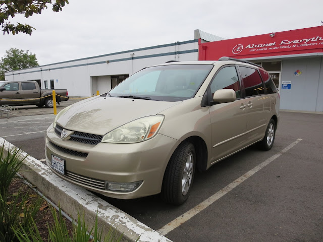 Dented & scraped Toyota Sienna before collision repair.