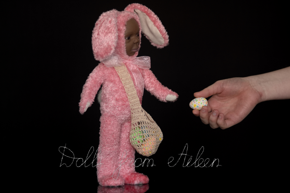 ooak Easter Bunny teddy doll with human hand holding an Easter egg