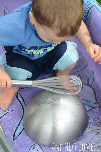 Kid enjoying a musical science pool experiment