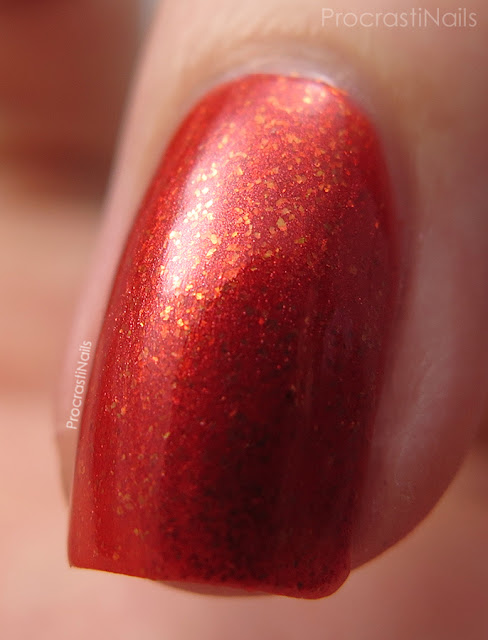 Macro of Dollarama Mariposa Orange Flakie Nail Polish