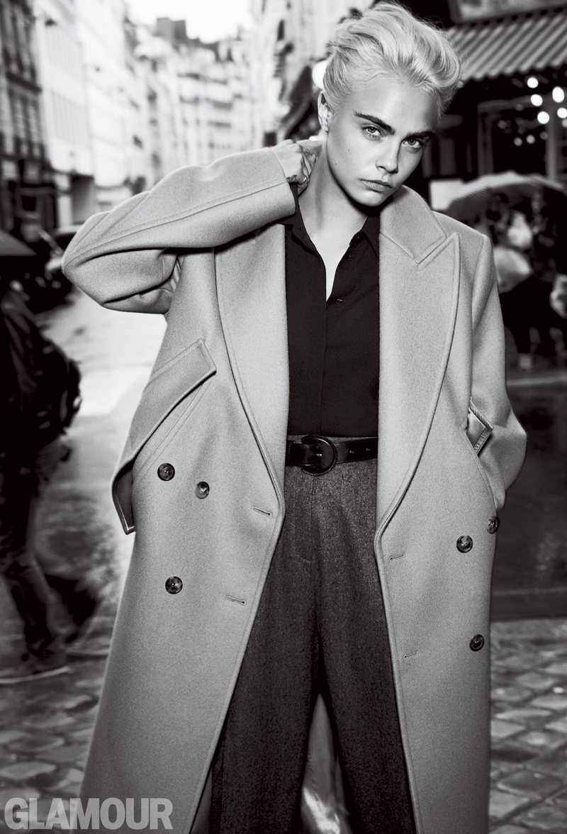 Cara Delevingne poses in Michael Kors Collection coat, blouse, trousers and belt