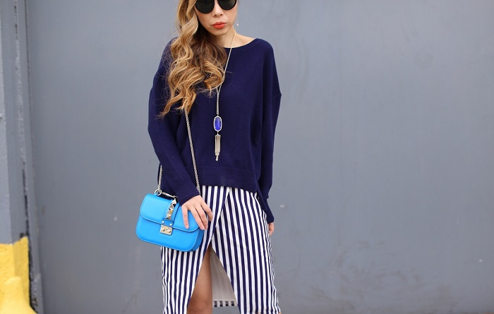 Leith Stripe Asymmetrical Pencil Skirt, Leith Slouchy Cotton Sweater, alice and olivia lace up booties, valentino lock bag, kendra scott necklace, drop earrings, karen walker harvest sunglasses, spring outfit
