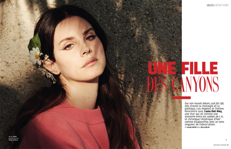 Photographed by Hilary Walsh, Lana Del Rey wears DKNY sweater