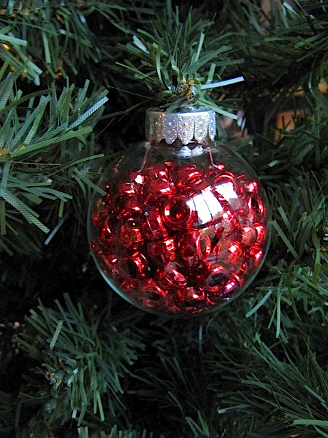 small glass christmas tree with ornaments