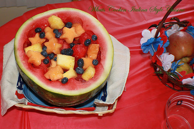 Watermelon carved out and filled with various cookie cutter shaped images for a festive 4th of July Fruit Bowl