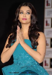 Aishwarya Rai Bachchan looks mesmerising in a teal blue Azzi and Osta gown