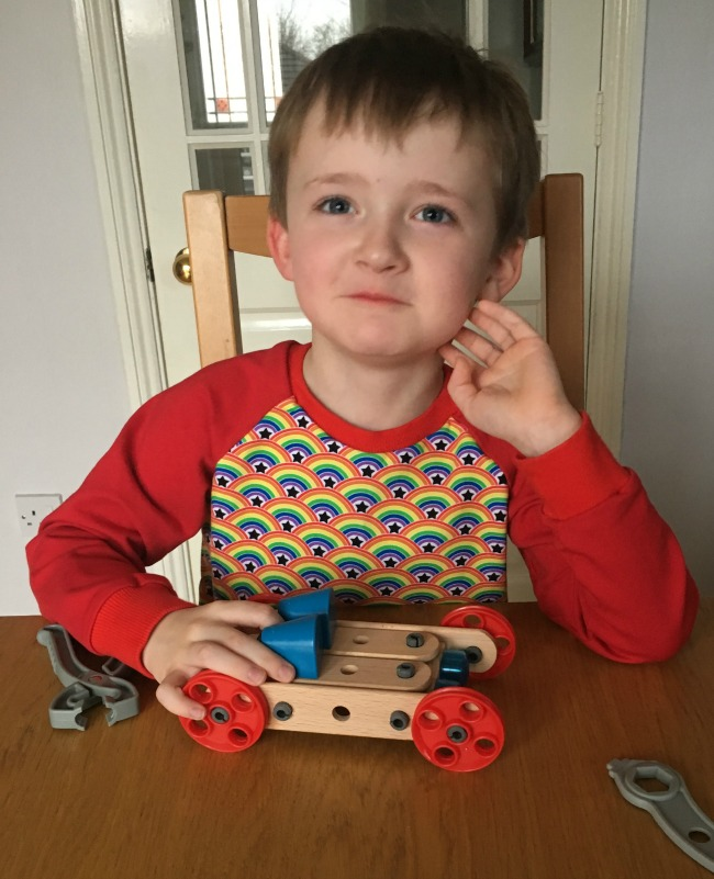 proud-boy-with-completed-car-from-Brio-Builders-Starter-Set