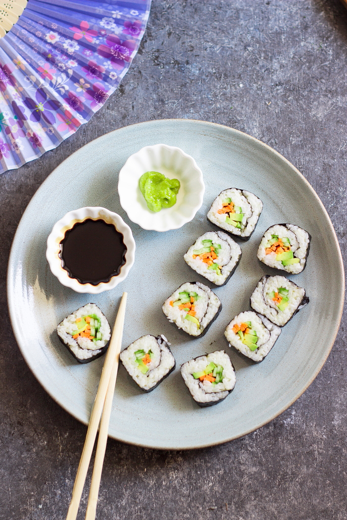 Avocado, cucumber, carrot vegan maki sushi roll