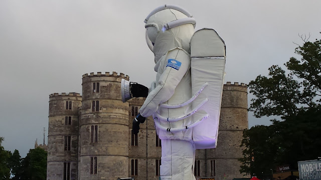 giant spaceman by a castle