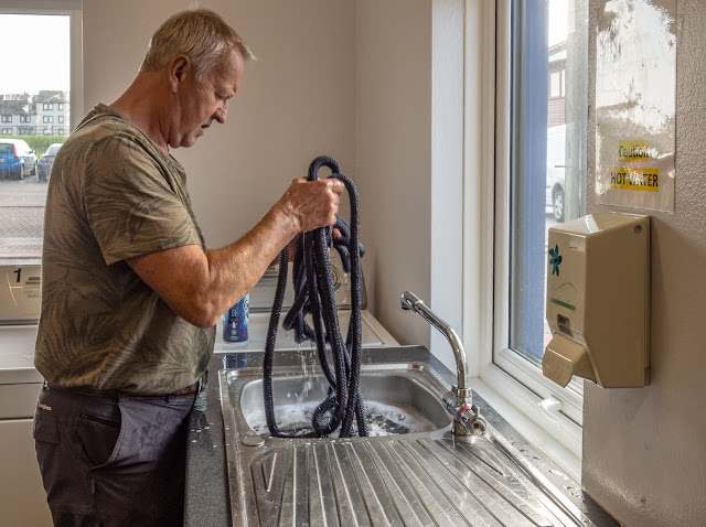 Photo of Phil washing our mooring ropes
