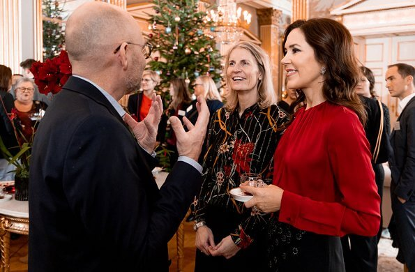 Crown Princess Mary wore a red sil blouse by Hugo Boss. Boss Banora8 blouse. black embroidered skirt at Christmas reception