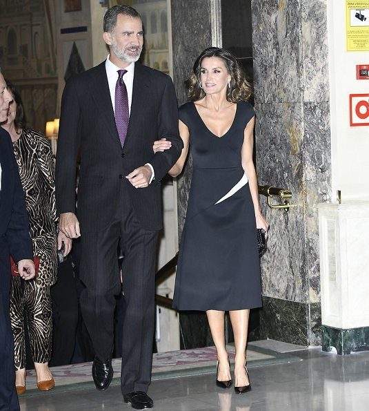 Queen Letizia wore Carolina Herrera dress and Carolina Herrera Pumps. carried Bottega Venata clutch bag. journalist Rubén Amón