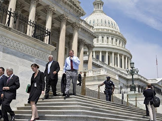 Members of Congress walk down the steps of the House of Representatives on Capitol Hill i